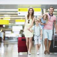 Family walking through airport